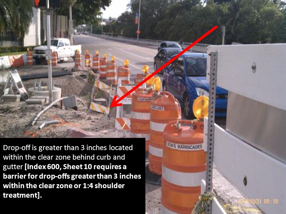 Drop-off is greater than 3 inches located within the clear zone behind curb and gutter [Index 600, Sheet 10 requires a barrier for drop-offs greater than 3 inches within the clear zone or 1:4 shoulder treatment].